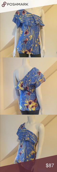 MWT Elie Tahari Silk Ruffle Blouse MWT Elie Tahari Silk Ruffle Blouse...gorgeous!...100% silk in cornflower blue, yellow and purple...one shoulder with graduated ruffle...flattering slightly longer length...dry clean. Retail $298 Elie Tahari Tops Blouses
