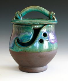 Yarn bowl--ok, I have never seen one of these. The artist says it's for knitters with kitties. Love it!