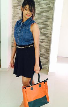 The season's chic with denim shirt, skater skirt and a trendy tote