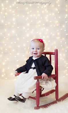 Christmas Photo idea. 9 month old little girl. Christmas light backdrop. Board-home depot lights-Dollar General. Camera settings-Canon 35 mm. IS0 250 f1.2 natural light to the right of subject from a large window. Sherry Conrad Photography.