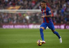 Neymar JR of Barcelona runs with the ball during the La Liga match between FC Barcelona and Malaga CF at Camp Nou stadium on November 19, 2016 in Barcelona, Catalonia.