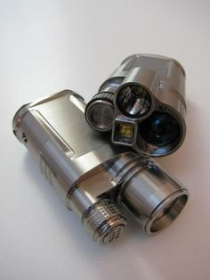 Tri-V custom flashlight | machined from aerospace grade titanium.  Capable of illuminating objects an entire football field away | MSRP 3295