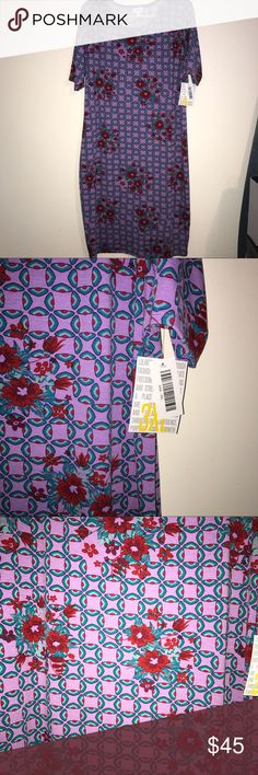 BNWT lularoe 3X Julia dress lavender w/red flowers BNWT lularoe 3xl Julia dress lavender background w/ red scattered flowers and red, blue & green all over pattern. Perfect for a casual day or work, but also can be dressed up for a night out! Due to its body hugging shape, I also have worn this style with a skirt over it so it appears to be a top/bodysuit. So versatile! LuLaRoe Dresses Midi