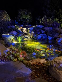 Seriously this pond is so beautiful. I took this photo and didn't even need to edit it. Pond lights and patio lights add hours of enjoyment to any water feature or pond. Waterpaw is the pond expert in Northern Michigan. Pond contractors and designers with over 30 years of water feature experience. Welcome to the Aquascape Lifestyle. Pond Landscaping, Ponds Backyard, Pond Design, Garden Design, Boyne City, Pond Lights, Traverse City Michigan, Garden Art, Garden Ideas