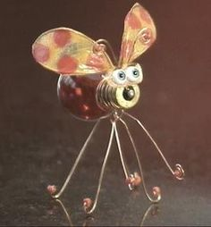 How to Make a Bug From a Light Bulb : Decorating : Home & Garden Television. I bought some of these at the Gypsy Caravan in St Louis last year. Mine are plant pokes, though, so I see them whenever I water the plants. They make me smile. These are cute, too.