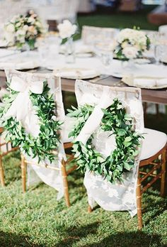 Wedding Reception Chair Decorations: White Reception Chairs with Greenery Wreaths