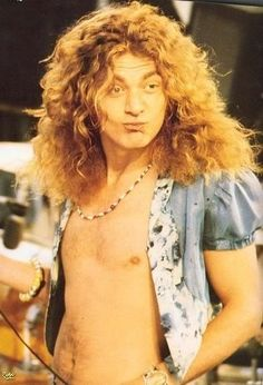 Robert Plant -  I had the most serious crush on him ever!  Physical Graffiti was my first Album!  What a great choice.  Given to me by one of my boyfriends! ♥