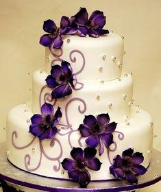 Purple flower wedding cake. Minus purple flowers plus black eyed susans or small sunflowera