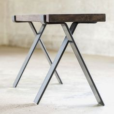 """Bold MFG is proud to offer our Cross Legs from the Flatform series. This pair of bench legs is cold formed from 3/8"""" x 3"""" flat bar steel and receives a oiled finish that is well suited for indoor use."""