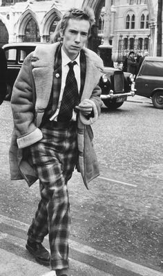 Anarchy hit the UK in the 1970s, with Vivienne Westwood and the Sex Pistols hand-delivering us punk. Ripped shirts and safety pins were worn with as much tartan that could be found. Look at Johnny Rotten in his tartan suit, creepers and shearling coat.