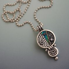 Sterling silver little medallion pendant necklace with blue teal green iridescent black and white mosaic inlay polymer clay sterling bead