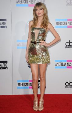 Pin for Later: Taylor Swift's Insuring Her Legs For How Much?! Taylor Swift at the 2013 American Music Awards Long hair, don't care . . . because this was just the beginning her sexy, leg-baring style.