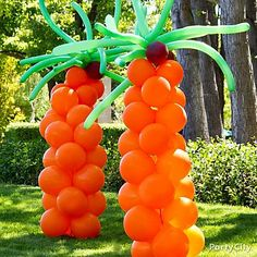 DIY balloon palm trees, complete with coconuts! We love how balloon creations make a big splash for just a little cash!