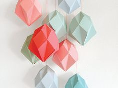Fold your own geometric diamonds and decorate in any style.  With this laser cut template made from birch triplex you can make as many gems as