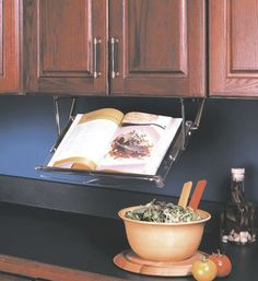 The Under Cabinet Cookbook Holder is made from durable clear acrylic and will hold most cookbooks.