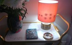 Orange silk Archive shade with vintage Jersey pottery base clementine and bloom