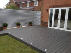 Garden decking and patio ideas for gardens small and large from traditional brick paving to modern tiles and wooden decking See more ideas about Garden decking ideas lig Small Garden Decking Ideas, Garden Ideas Uk, Patio Ideas, Backyard Ideas, Small Back Garden Ideas, Small Backyard Decks, Small Decks, Small Garden Patios, Decking Ideas On A Budget