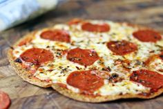 Deliciously melty Pepperoni Pizza baked onto a whole wheat tortilla for only 6 WW points! You won't miss your normal thin crust pizza after you try this for the first time.