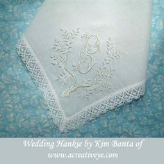 Wedding handkerchief.  Alphabet heirloom machine embroidery designs instant download.  This design is the tree of life blank by Sonia Showalter designs.  The font is by ABC Embroidery Designs, chocolate punch, 3 sizes.