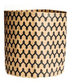 Beige/zigzag. Cylindrical storage basket in reinforced paper. Diameter 8 3/4 in., height 9 3/4 in.