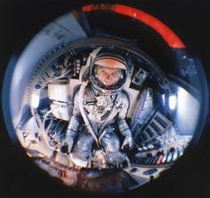 Fish-eye view of Mercury astronaut John Glenn training in a mock-up of a space capsule, 1959. Photo by Ralph Morse, LIFE magazine.