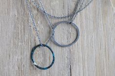 Two circles necklace: oxidized sterling silver and blue copper