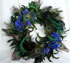 Peacock Feather Wreath Teal Royal Blue Home Decor Original Peacock design Last One Made in Michigan. $74.95, via Etsy.