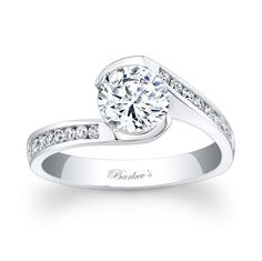 Channel Engagement Ring - 7859LW - Bold contemporary styling makes a strong statement of confidence for the person who wears this diamond engagement ring. A take on the vintage bypass ring of day gone by, this modern version has a channel set round diamond center and channel set diamonds grace it's shoulders. Also available in yellow, 18k and Platinum.