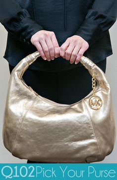 Michael Kors - Gold Hobo. Go to wkrq.com to find out how to play Q102's Pick Your Purse!