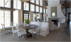 Reclaimed timbers and a grand fireplace in a great room overlooking the lake. Southern Accents.
