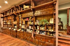 19th century German grocer's back bar used for storage and organization in historic Victorian home.