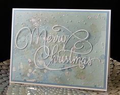 Christmas 2016 Gina Marie Designs Merry Christmas die cut in silver glitter paper. watercolor paper with silver. Created by Peggy Dollar