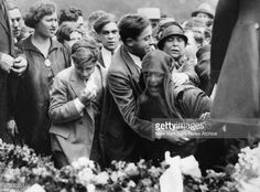 Friends comfort gangster Frankie Yale's ex-wife at the gangster's funeral.