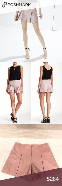 """New $498 Rebecca Minkoff leather shorts Brand new (without tags) $497 Rebecca Minkoff leather shorts. Inverted pleats accent the front of a high-waist lambskin short that's finished with chevron topstitching along the waistline. - Zip fly with snap closure - Approx. 10.5"""" rise, 4.5"""" inseam - Lined - Imported Fiber Content Shell: 100% lambskin Lining: 100% polyester Rebecca Minkoff Shorts"""