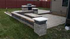 Simple multi tiered paver patio w/seating wall, fire pit, and grill island