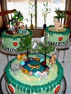 Jungle themed baby shower cake.  white with raspberry filling, chocolate with cherry filling and marble with strawberry filling.  Buttercream icing with sugar animal accents on the sides.