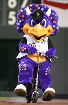 Dinger, a purple triceratops, hatched from his egg at Mile High Stadium on April 16, 1994.