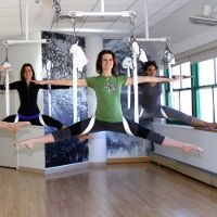 """Suspension yoga, also known as """"ariel yoga""""... difficult, but very cool! Requires a patient instructor and a willingness to step outside your usual boundaries :)"""