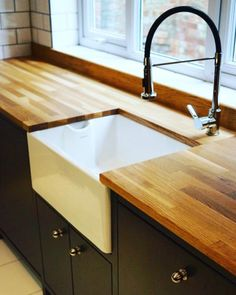 A combination of oak worktops and a Belfast sink gives this kitchen classic luxury appeal.