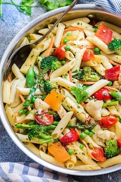 This Pasta Primavera recipe comes together in under 30 minutes so it& perfect for busy weeknights. Best of all, it& chock full of spring vegetables. Chicken Pasta Recipes, Veggie Recipes, Vegetarian Recipes, Cooking Recipes, Healthy Recipes, Dinner Recipes, Parmesan Recipes, What's Cooking, Healthy Options