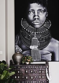 Sometimes bigger is better. Work in a large artistic print to set the mood for the room. Emphasize with minimal character pieces. Handmade Sliced Conical Shell Neckpiece - Home By Tribal