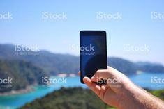 Hand Holding Mobile Phone Taking Photo of Landscape. Your Design Here on Phone! Royalty-Free Stockphotos for all your & Needs! See Link in Bio. Abel Tasman National Park, Kiwiana, Commercial Art, Landscape Photos, Image Now, How To Take Photos, Social Networks, Your Design, Hold On