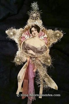 This 8 in star is embellished with a glass glittered round shaped tart tin. A lovely demure Renaissance woman in a lavender shawl graces the top.