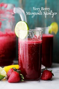 Very Berry Margarita Spritzer - A refreshing and delicious twist on the classic Margarita made with fresh berries, daiquiri mix and seltzer water. This is the perfect drink for parties and/or gatherings.