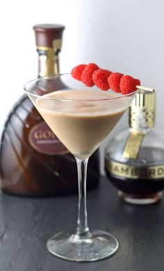 2 ounces chocolate liqueur 2 ounces raspberry liqueur 2 ounces vodka GARNISH fresh raspberries INSTRUCTIONS Combine all ingredients and ice in a cocktail shaker. Shake vigorously, then strain into a chilled martini glass. Garnish with fresh raspberries. Party Drinks, Cocktail Drinks, Fun Drinks, Cocktail Recipes, Beverages, Bourbon Drinks, Liquor Drinks, Coffee Cocktails, Chocolate Martini