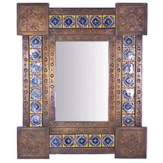 This unique aged Mexican tin and Talavera mirror is a work of art guaranteed to make a design statement on any wall in your home!
