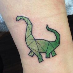 Geometric dinosaur tattoo by Cody Brigan