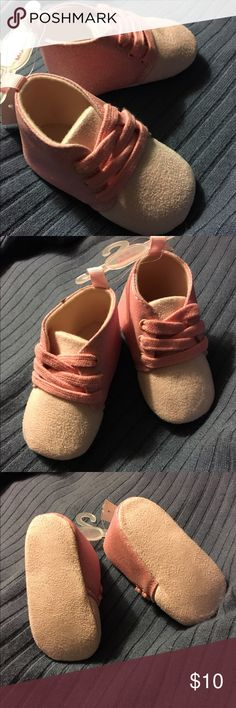 NWT Pink Sparkle Glitter Boots Infant 6-9 Months New with tags Infant Girls pink sparkle glitter boots are soft to the touch and size 6-9 Months. Darker pink color is the sparkle glittery part. The soft parts are the light pink color. Shoes have laces. Made in China. Shoes Boots