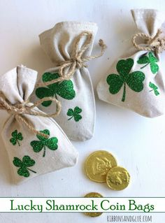 Lucky Shamrock Coin Bags made out of drop cloths, Silhouette and heat transfer vinyl. Easy DIY St. Patrick's Day craft filled up with gold coins for luck.