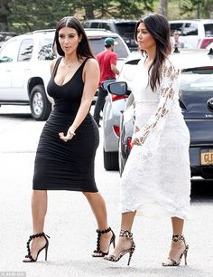 Done up to the nines: Kim showed off her famous curves in a figure-hugging black dress and matching heels